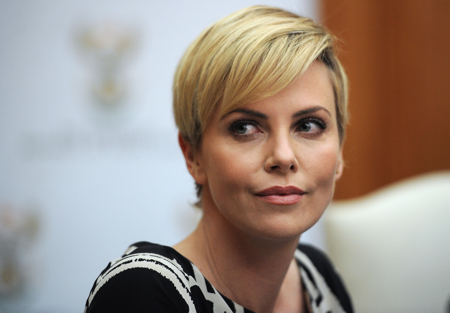 South African-born Hollywood actress and UN Messenger of Peace Charlize Theron attends a press conference on July 29, 2013, at the Unions Building in Pretoria. Theron is accompanied by the Executive Director of UNAIDS Michel Sidibe to discuss the strides being made in the fight against HIV and AIDS and how collaboration can assist mitigate the pandemic's negative impact on young girls. They will also explore ways to support South Africa's efforts to enable young women and girls to lead healthier HIV and AIDS-free lives. AFP PHOTO / STEPHANE DE SAKUTIN (Photo credit should read STEPHANE DE SAKUTIN/AFP/Getty Images)