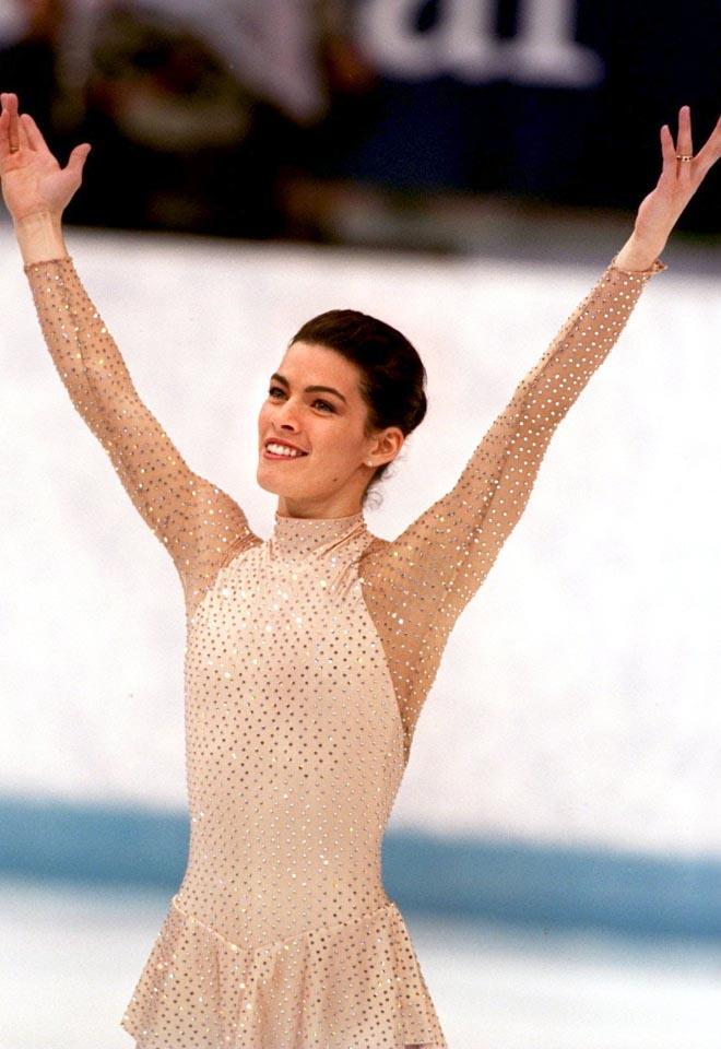 25 FEB 1994:  NANCY KERRIGAN ACKNOWLEDGES THE CROWD AFTER FINISHING HER LONG PERFORMANCE AT THE FIGURE SKATING COMPETITION AT THE 1994 WINTER OLYMPICS IN LILLEHAMMER. KERRIGAN FINISHED IN SECOND PLACE. Mandatory Credit: Chris Cole/ALLSPORT