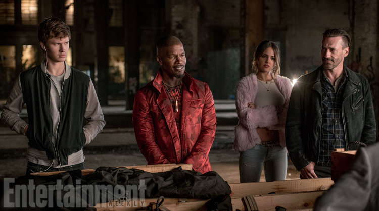(l to r) Baby (ANSEL ELGORT), Bats (JAMIE FOXX), Darling (EIZA GONZALEZ) and Buddy (JON HAMM) in the abandoned rail yard to negotiate a deal in TriStar Pictures' BABY DRIVER.